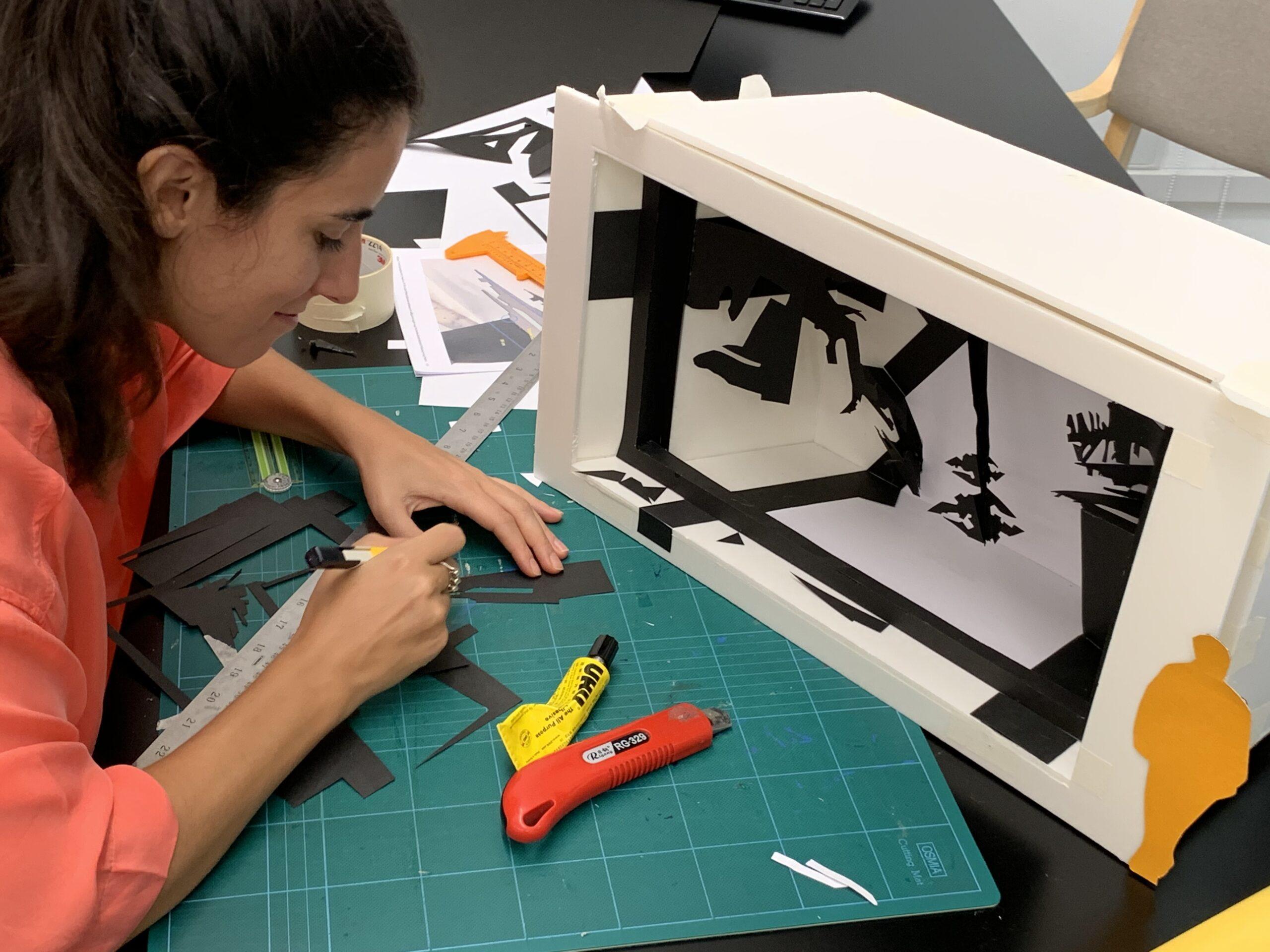 Madalena working on the SFH model, Impromptu Inc Macau